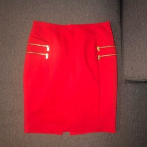 Red pencil skirt with gold zippers